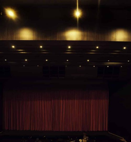 theatre stage with red curtains close